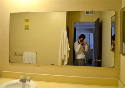 diy framing large bathroom mirror bathroom mirrors rachel schultz framing a bathroom mirror with pallets