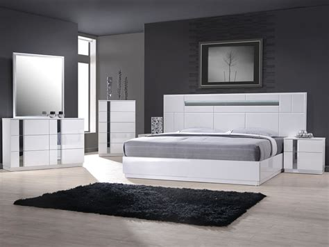white modern platform bed with lighted headboard