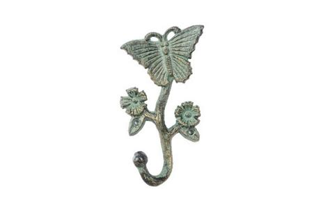 iron butterfly flowers and antique seaworn bronze cast iron butterfly with flowers