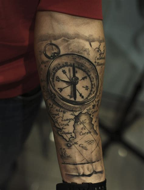 world map and compass tattoos on forearm photos