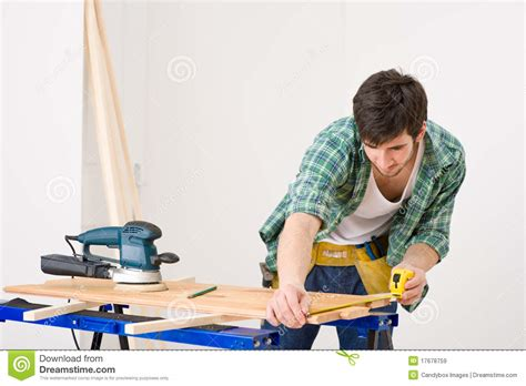 home improvement handyman prepare wooden floor royalty