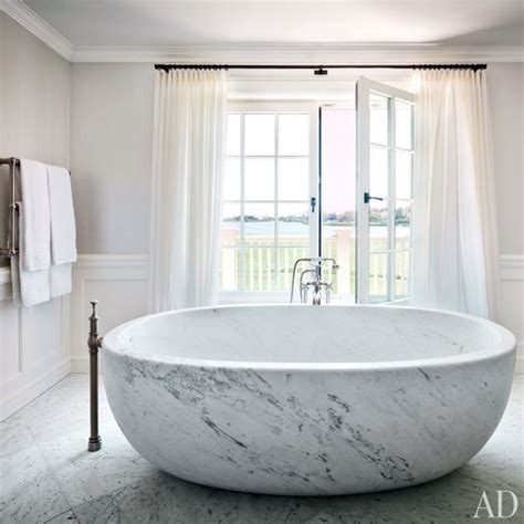 Bathub Standing Oshin Marble marble bathtub transitional bathroom architectural digest