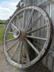 two men and a little farm wagon wheel herb garden