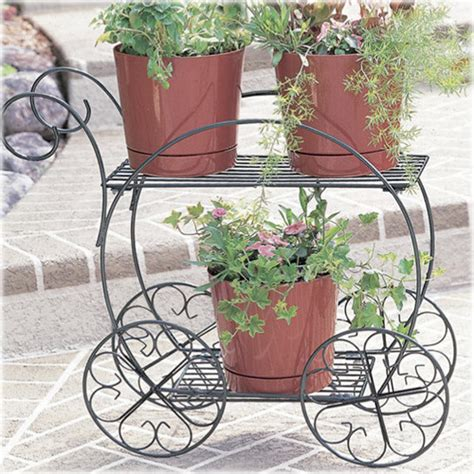 And Cart Planter by Two Tiered Garden Cart Traditional Wheelbarrows And