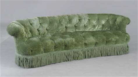 green velvet tufted sofa a button tufted sofa upholstered in green velvet second