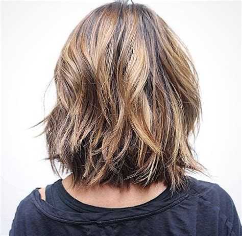 medium shorter in back hairstyles back view of a long bob layered haircut pinterest