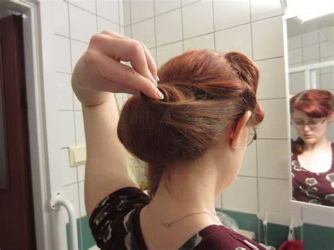 rolling up your hair in curls in preparation for an updo swingin it in vintage tutorial for a classic chignon
