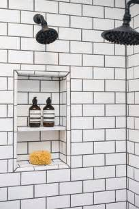 Shower with black and white moroccan tiles mediterranean bathroom
