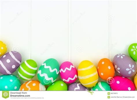 Green And Purple Home Decor by Easter Egg Border Against A White Wood Background Stock