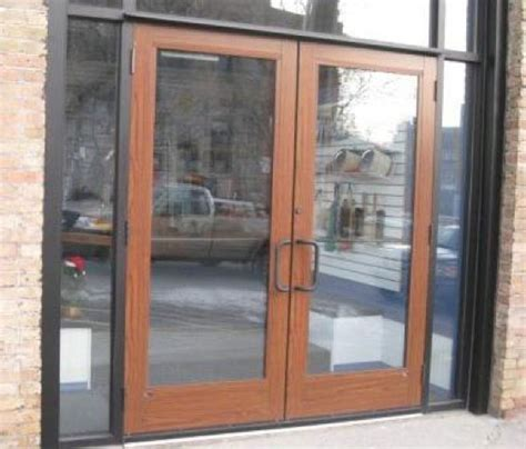 Store Front Door Wood Grain Store Front Doors W Faux Wood Powder Coating By Decoral
