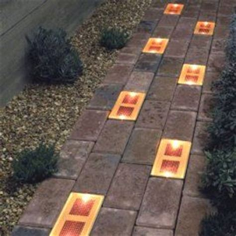 these solar brick lights would be great along the edges of