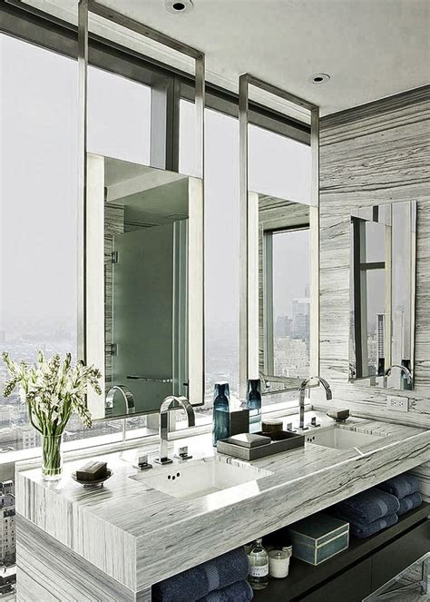 luxury bathroom mirrors led mirrors suspended from the ceiling at one madison park