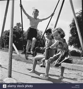 1950s Swing Historical 1950s Three Small Children Play Outside On A