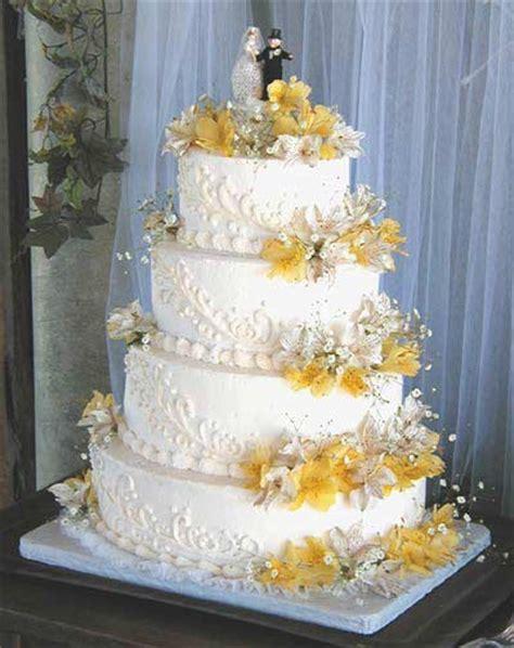 savage magazine yellow flowers wedding cake