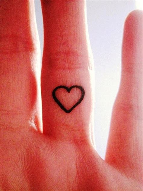 finger tattoo disappearing heart ring tattoo design busbones