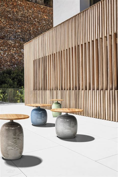 outdoor interiors tna2000 20 in round teak outdoor accent 3 new outdoor products in indonesian teak by gloster