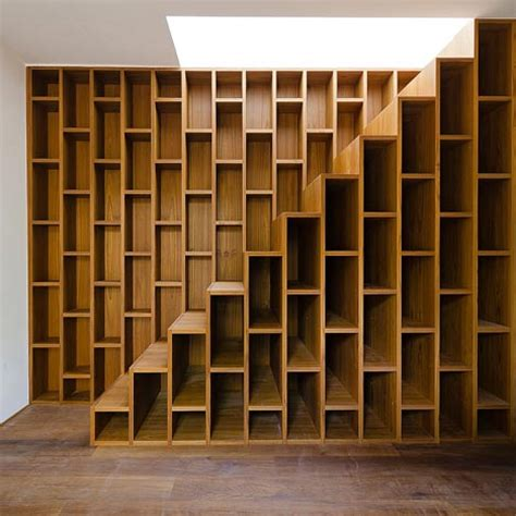 bookshelves stairs staircase bookcase warm functional storage area