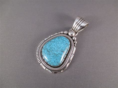 kingman turquoise pendant by will vandever two grey