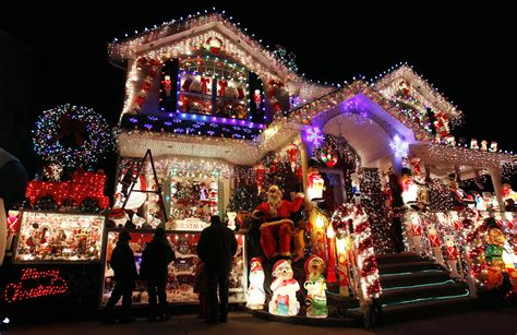 christmas decorated houses a house is seen decorated with christmas lights in the
