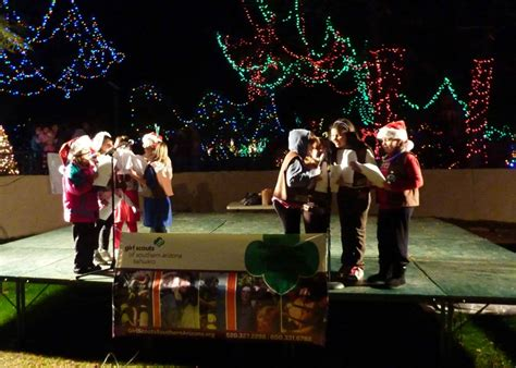 Girl Scouts Caroling At Tucson S Reid Park Zoo Lights Event Tucson Zoo Lights