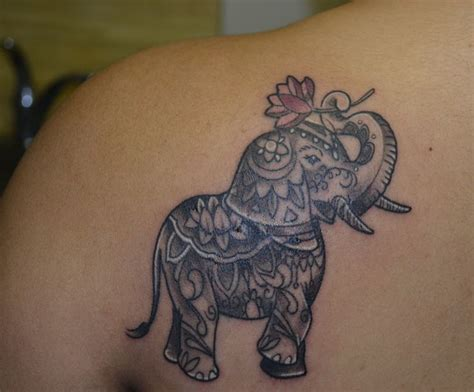 elephant tattoo meaning yahoo elephant tattoos with trunk up google search tattoo