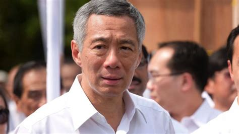 singapore pm lee hsien loong shares grief after death of singapore first family feud escalates as pm lee accused of