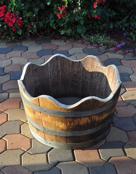 wine barrel planters best 25 wine barrel planter ideas on wine
