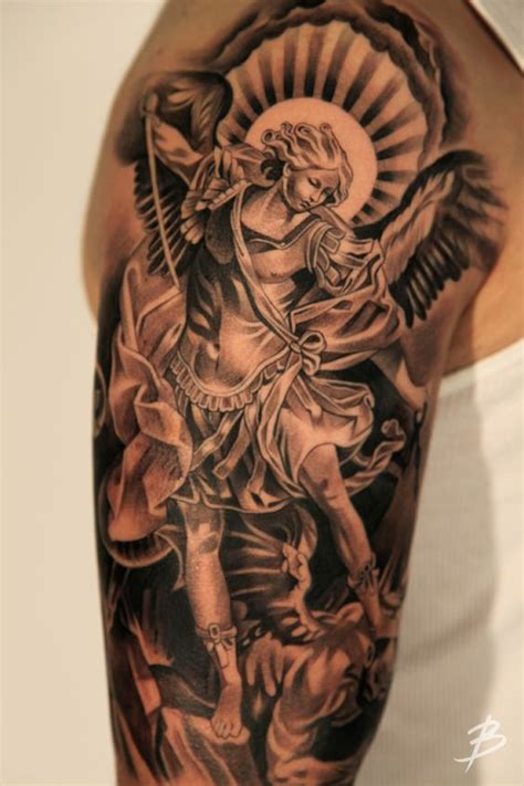 fighting angel tattoo designs 140 heavenly tattoos that will make you believe
