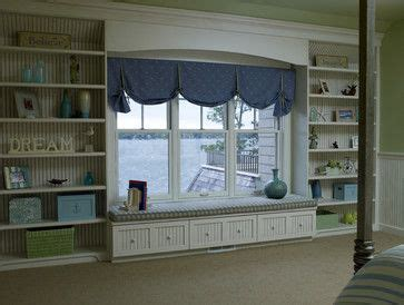 window seat flanked by bookcases window seats bookcases and window on