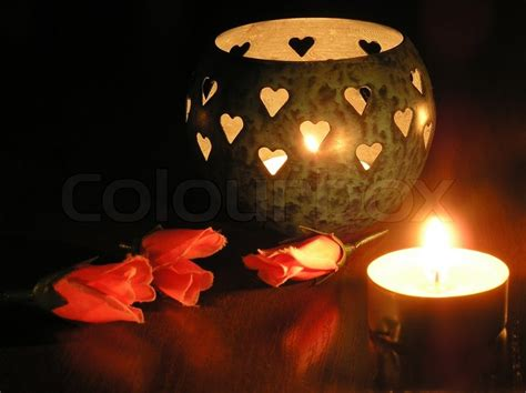 candele rosse candle in a candlestick and a stock photo colourbox