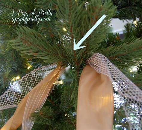 criss cross ribbon with bows on christmas tree how to add ribbon to a tree part two a pop of pretty canadian home decorating