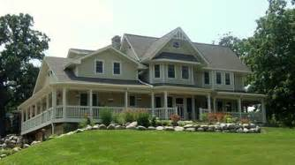 craftsman farm house wrap around porch floor plans big with large shingle driveway garaging and bush