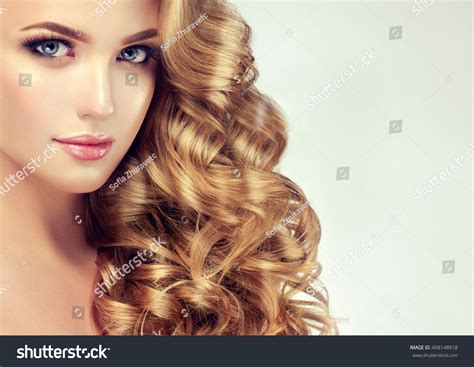 beautiful model with elegant hairstyle stock photo blondel girl with long wavy hair beautiful model with