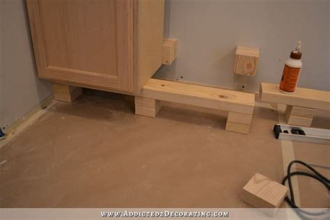 how to level kitchen base cabinets kitchen cabinet installation underway