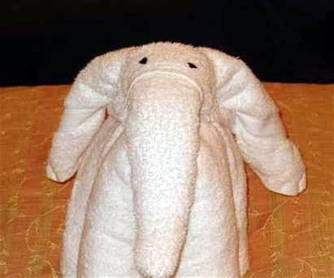 how to fold a towel like an elephant popsugar home