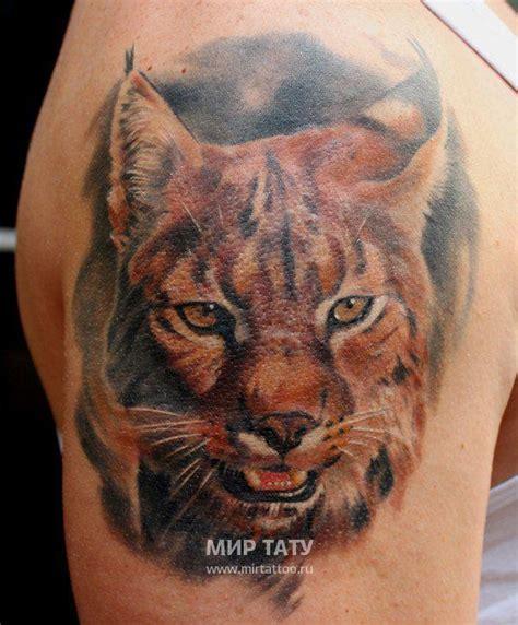 3d realistische sehr detaillierte wildkatze tattoo an der