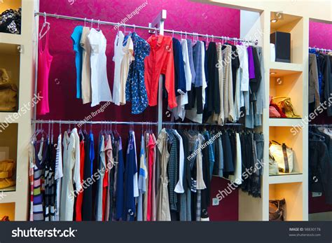 Rack Shopping by Shop Different Clothes Shopping Racks Shelves Stock Photo