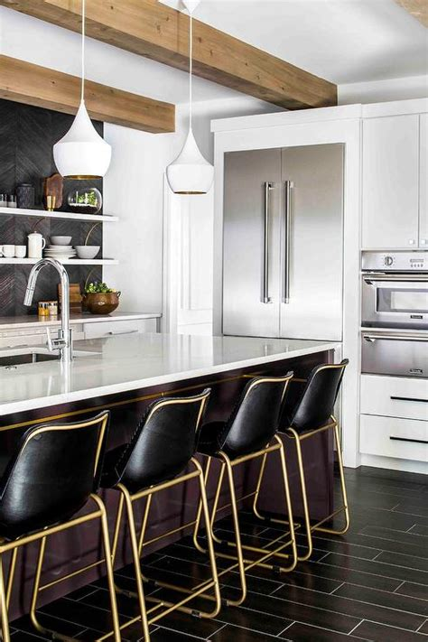Gold and Black Barstools with White Tom Dixon Beat Lights