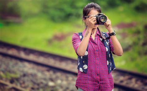 woman holding black dslr camera  stock photo