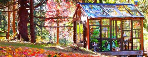 artist builds incredible stained glass cabin   middle   woods inhabitat green