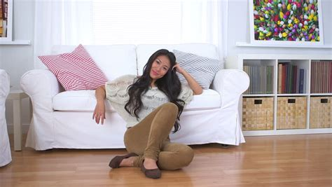couch dance mature woman jumping on couch and dancing in living room