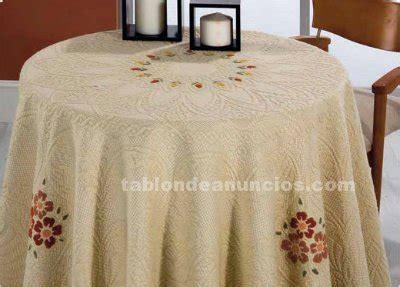 tablon de anuncios  mesas camilla  falda  estufa