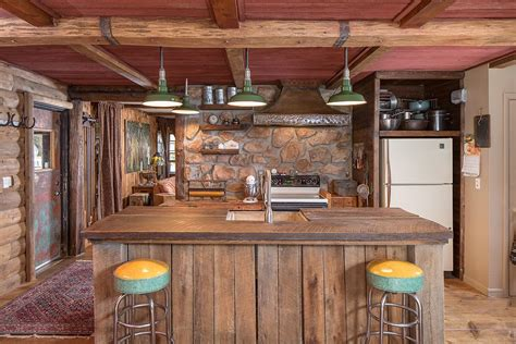 hand crafted rustic barn wood kitchen island by black rustic kitchen with custom hood hardwood floors in
