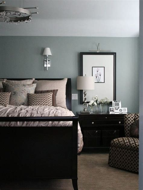 master bedroom with black furniture black furniture with walls that are blue with a green tint