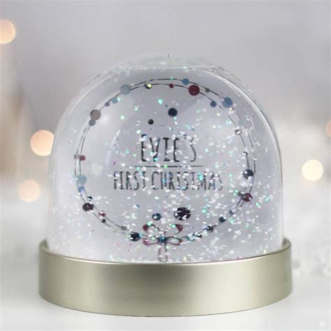 personalised first christmas snow globe by rocket and fox