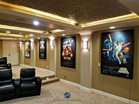 Home theatre room with textured acoustic tile ceiling movie posters carpet and stairs lenox