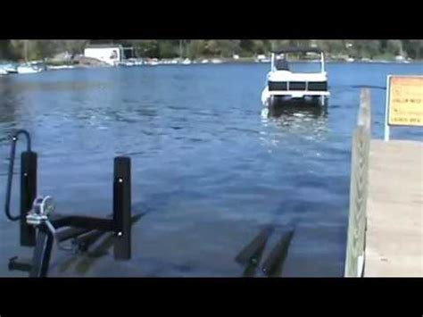tritoon boat trailer loading guides loading pontoon boat on float on trailer youtube