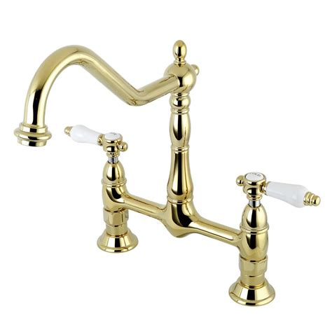 brass kitchen faucets kingston brass porcelain 2 handle bridge kitchen faucet with lever handle in polished