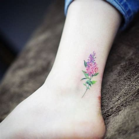 15 of the smallest most flower tattoos small
