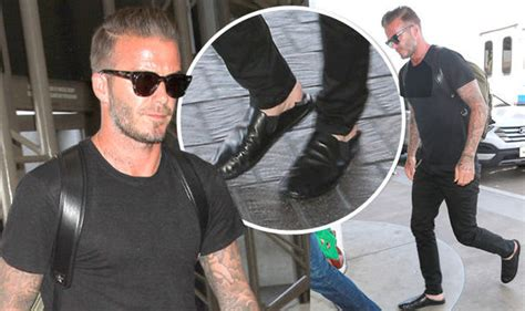 Beckham Makes Oxfam Fashionable by David Beckham Turns Heads In Backless Leather Slippers
